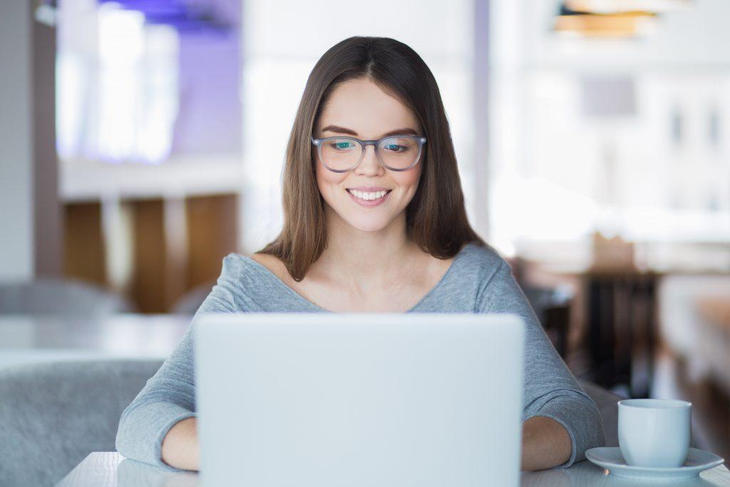 woman looking at laptop teaching english online